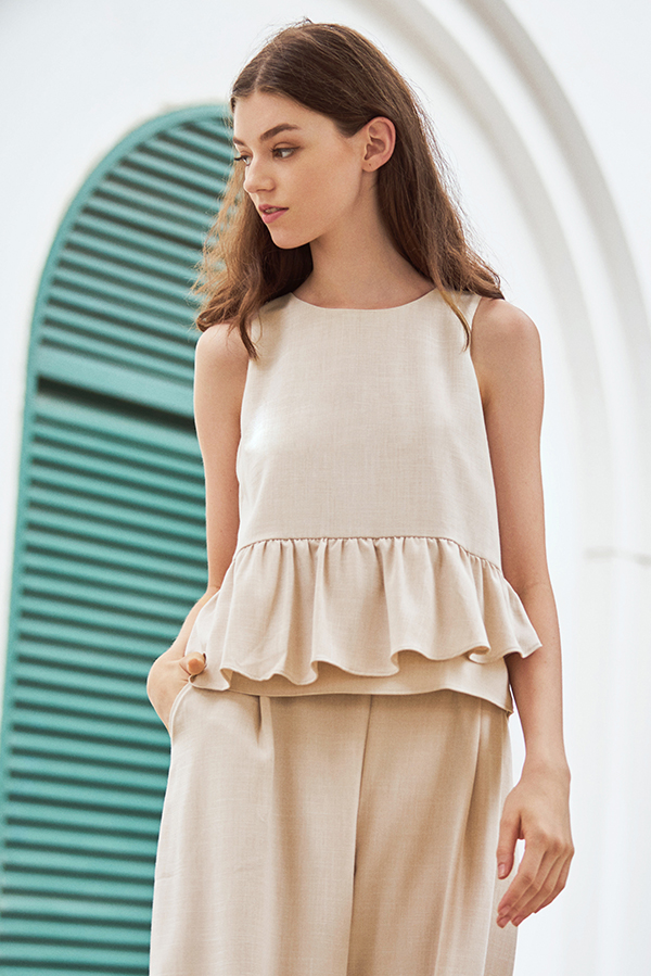Merlane Peplum Top in Cream