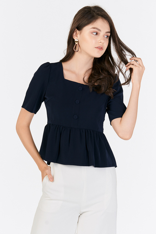 Denara Peplum Top in Navy