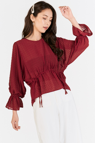 Laudette Dotted Peplum Sleeved Top in Wine